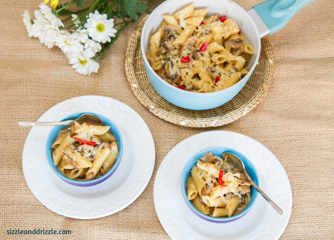 Pasta in a pot and bowls