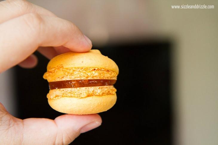 Mango Macaron held in hand